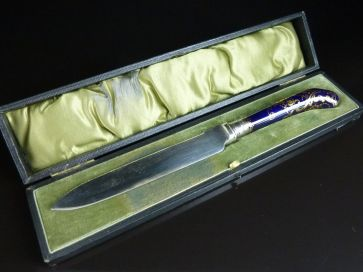 ENAMEL & GILT HANDLED CAKE KNIFE