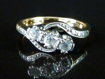 3 STONE DIAMOND TWIST RING