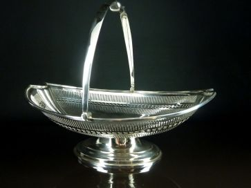 E.P. SILVER SWING HANDLED BASKET