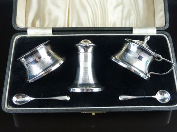 SOLID SILVER CASED CRUET SET