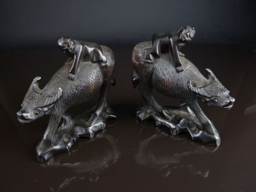 PAIR OF CARVED OX WITH HERD BOYS