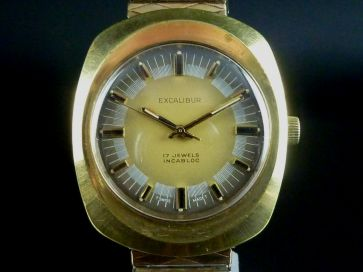 EXCALIBUR GOLD TONE WATCH
