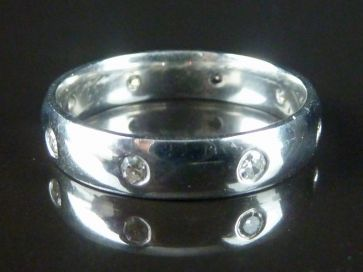 7 STONE DIAMOND BAND RING